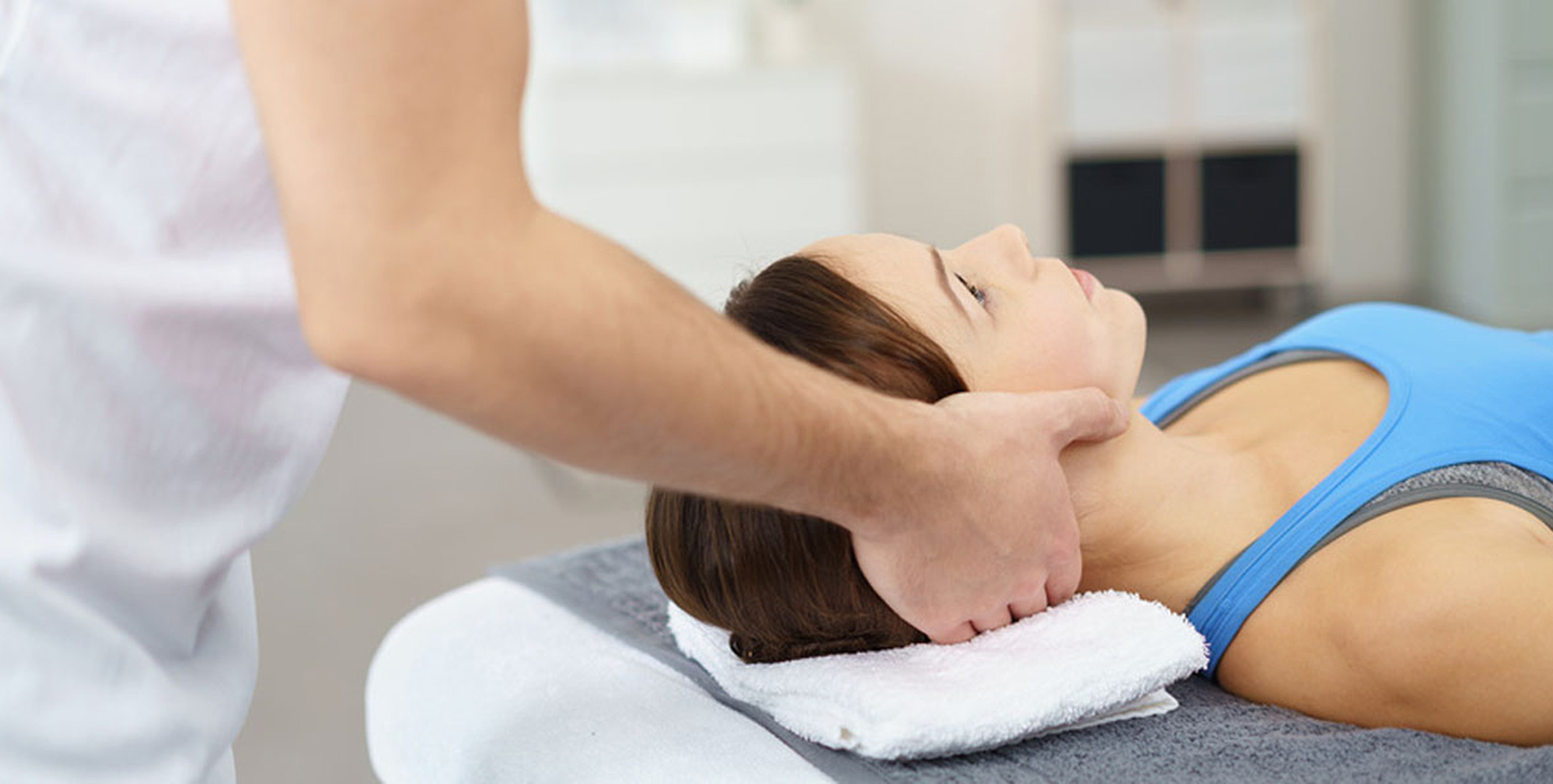 Physiotherapy-Woman-receiving-physio-treatment-to-her-neck2